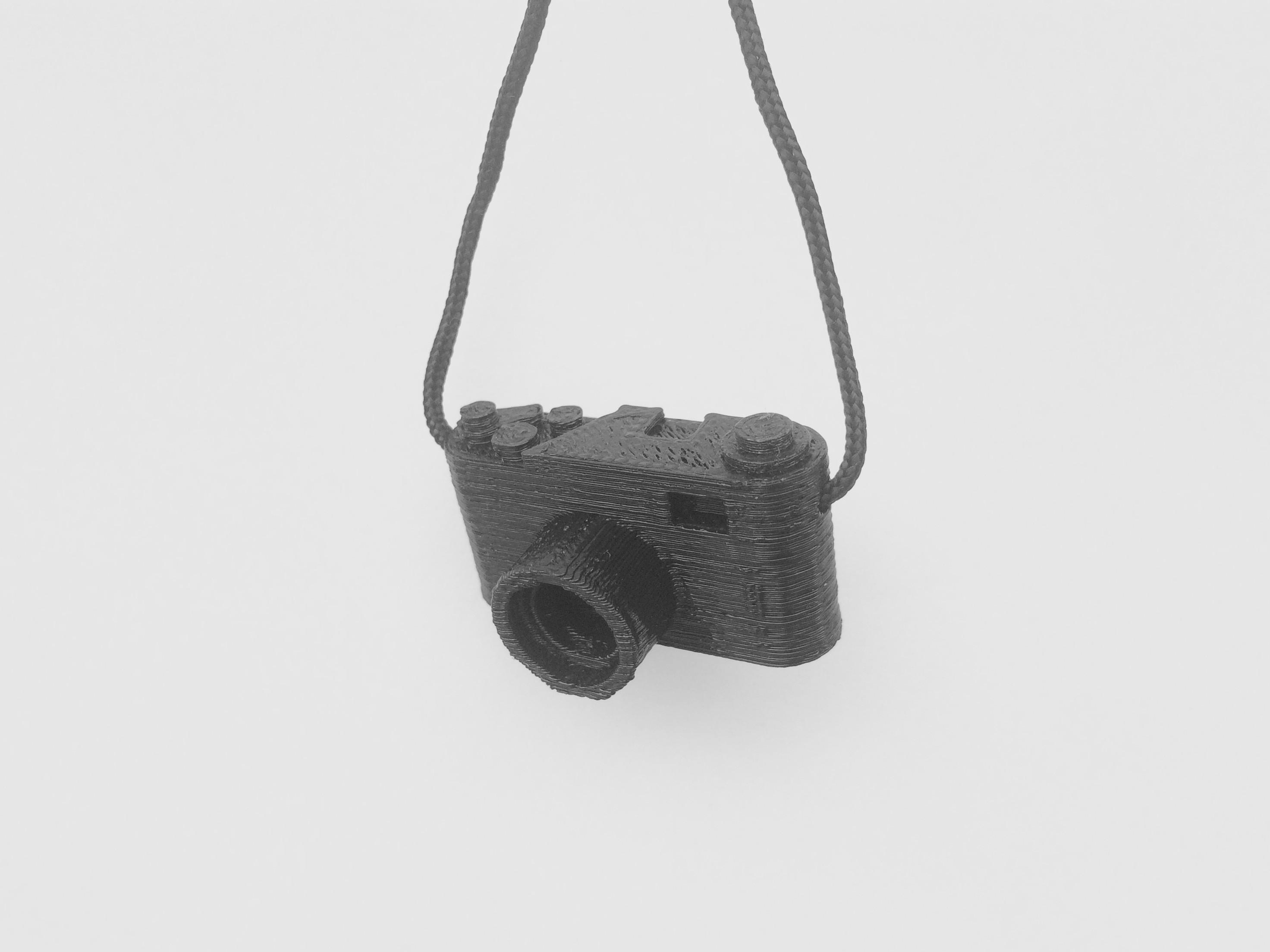 FullSizeRender 11.jpg Télécharger fichier STL gratuit porte-clés caméra • Design pour imprimante 3D, alber