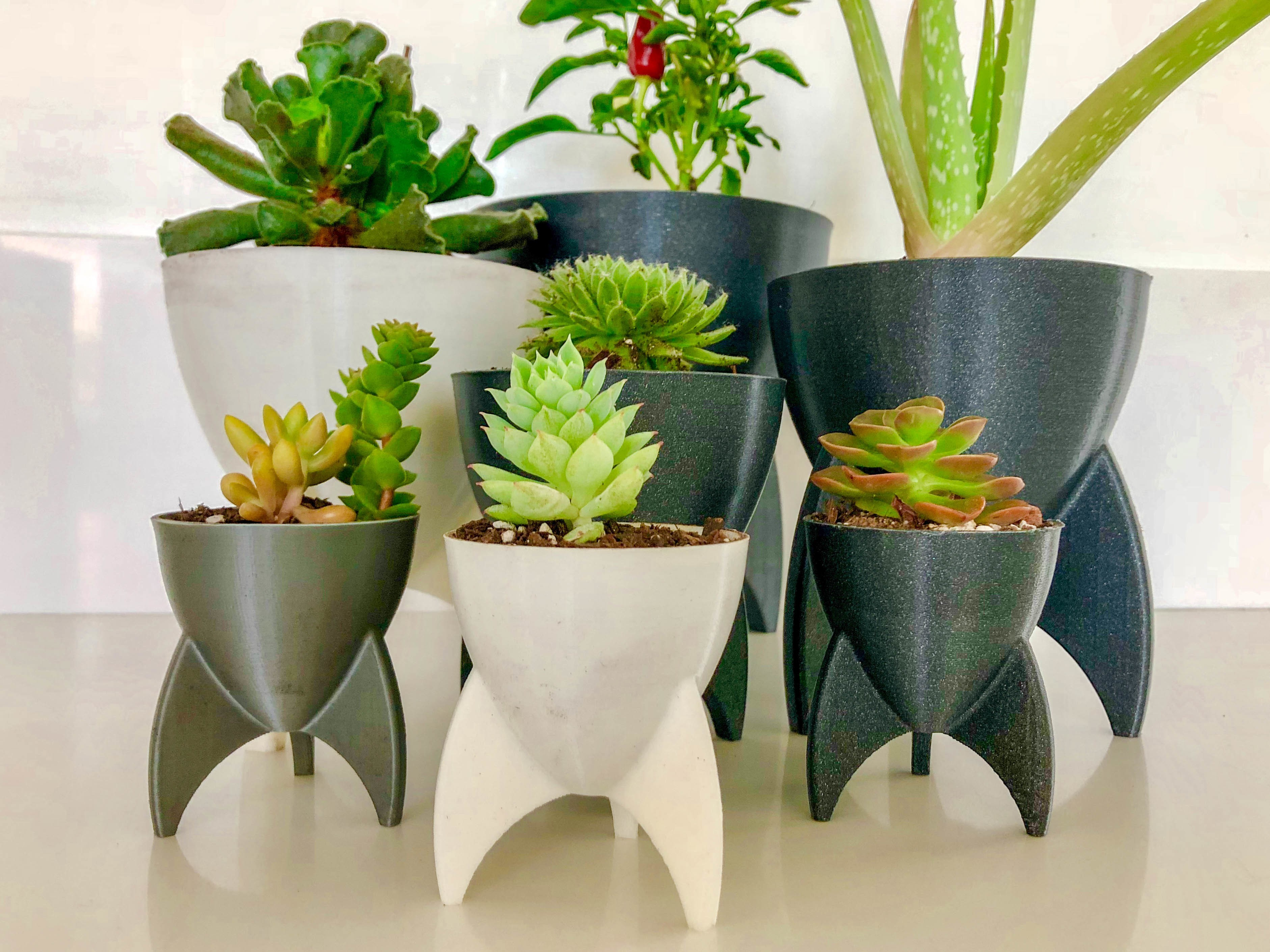 rocketplanters.jpg Download free STL file Retro Rocket Planter / Pencil Cup • 3D printing template, printfutura