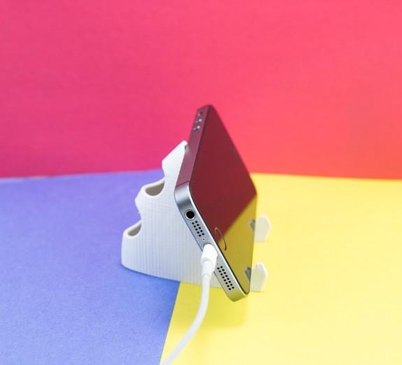 2c15b77b1880f541068ada401446e857_1443225096089_NMD000070g_1x.jpg Download free STL file Phone Stand • Model to 3D print, FerryTeacher