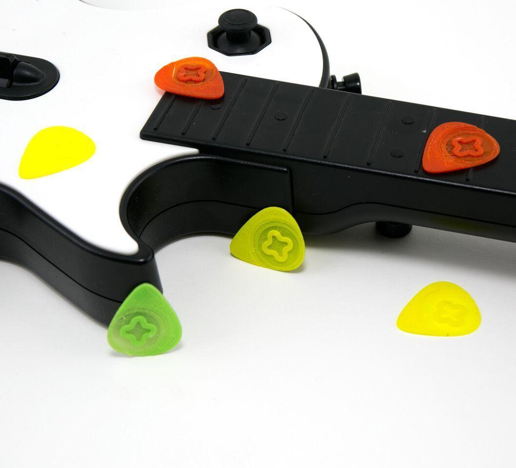 47809dfcb4370ce89b0db1b1b7434a93_1446492472050_NMD000403f_2x.jpg Download free STL file Guitar Pick • 3D printable model, Emiliano_Brignito