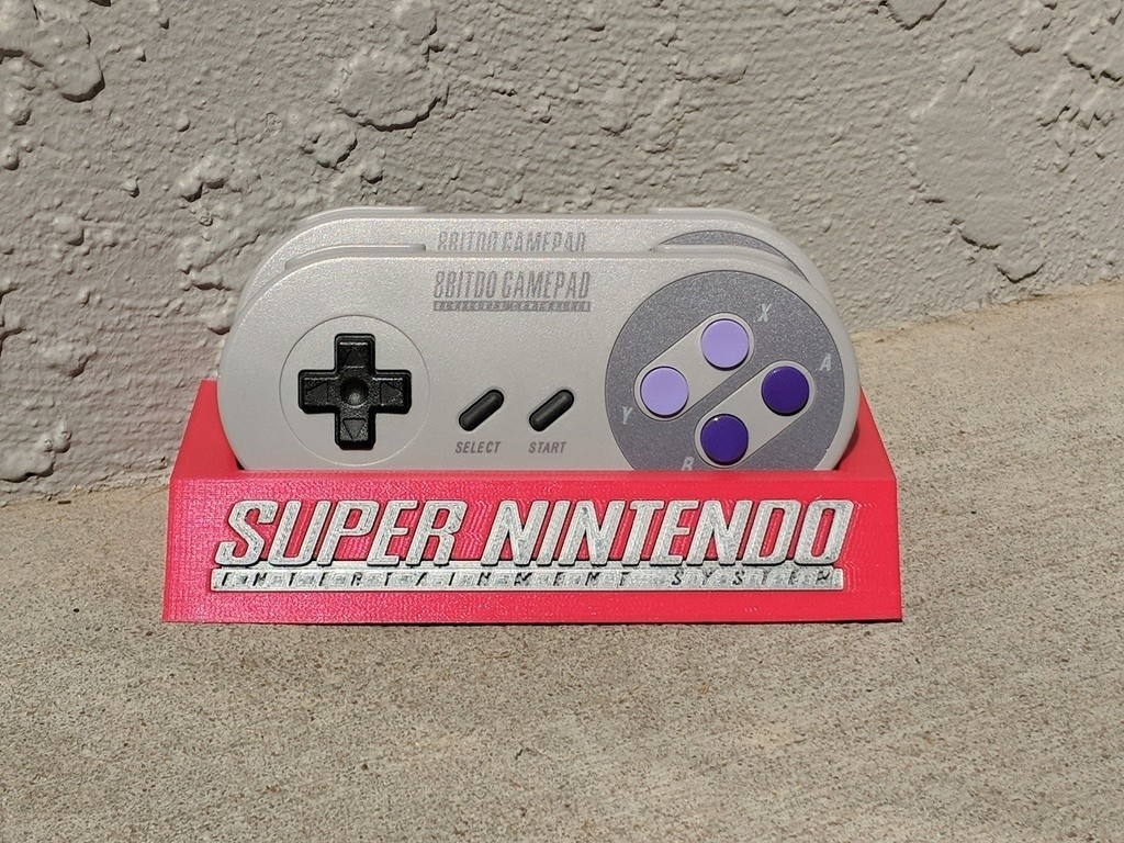 f9e467d7a70bed920fe5874ceed6ef31_display_large.jpg Download free STL file 8Bitdo SNES30/SFC30 Controller Holder • Template to 3D print, mark579