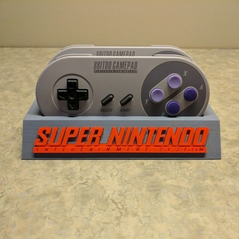 a88a96145ae7f2d6919b809c6ab39c02_display_large.jpg Download free STL file 8Bitdo SNES30/SFC30 Controller Holder • Template to 3D print, mark579