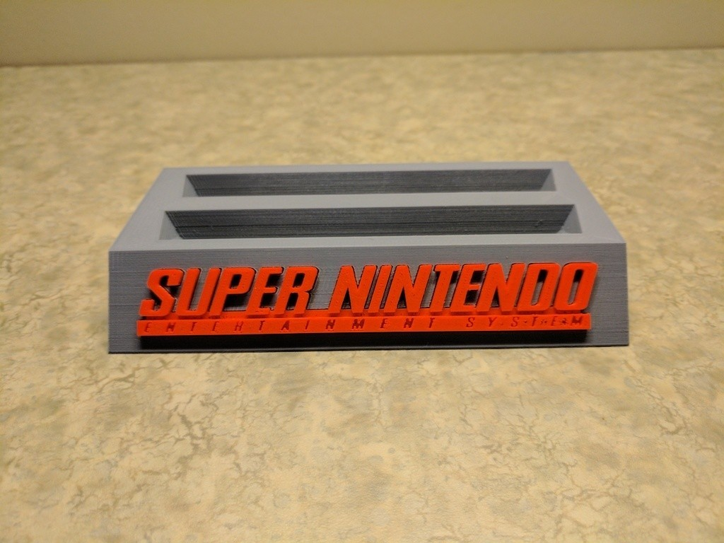 bae668280521082fe27e714d1351f62f_display_large.jpg Download free STL file 8Bitdo SNES30/SFC30 Controller Holder • Template to 3D print, mark579