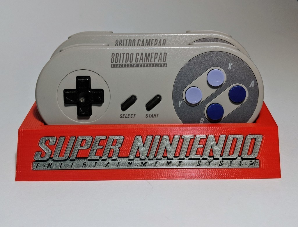 bc302475b03b875df41e75524215bada_display_large.jpg Download free STL file 8Bitdo SNES30/SFC30 Controller Holder • Template to 3D print, mark579