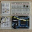 Download free 3D printer designs Cyclone II FPGA minimal development system and breadboard holder, arpruss