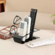 2.png Download free STL file Remote control and phone holder • 3D print model, osayomipeters