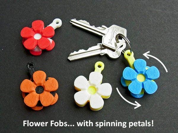 flowerfobs_display_large.jpg Télécharger fichier STL gratuit Fleurs Fobs..... Des porte-clés Flower qui tournent ! • Modèle pour impression 3D, Muzz64