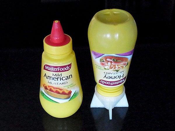 bottles_display_large.jpg Télécharger fichier STL gratuit Sauce Saver - Inverse les bouteilles avec une buse pour minimiser les déchets • Plan à imprimer en 3D, Muzz64