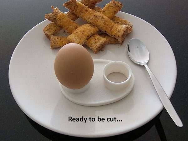 ready_display_large.jpg Download free STL file Boiled Egg Server - Neatly holds both parts of a cut boiled egg while it's being eaten. • 3D printable design, Muzz64