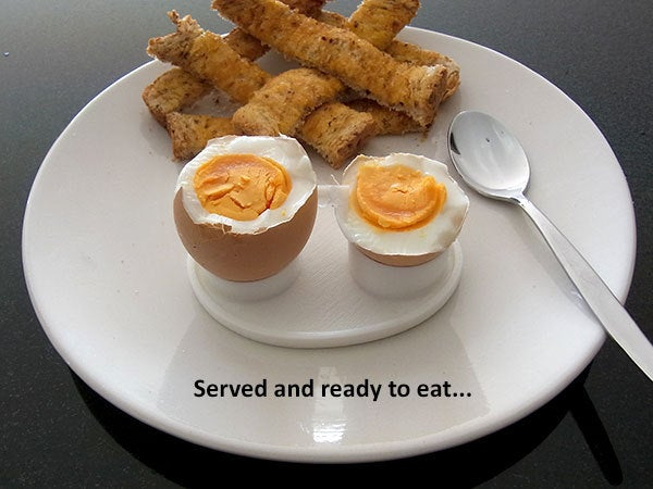 eat_display_large.jpg Download free STL file Boiled Egg Server - Neatly holds both parts of a cut boiled egg while it's being eaten. • 3D printable design, Muzz64