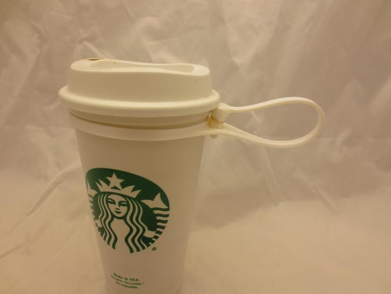 il_794xN.2200423196_eygm.jpg Download STL file Plug for Starbucks Hot Cup, Flexible plug for the standard reusable Travel To go Starbucks Venti grande coffee cup, doubles as belt strap • 3D print template, mechengineermike