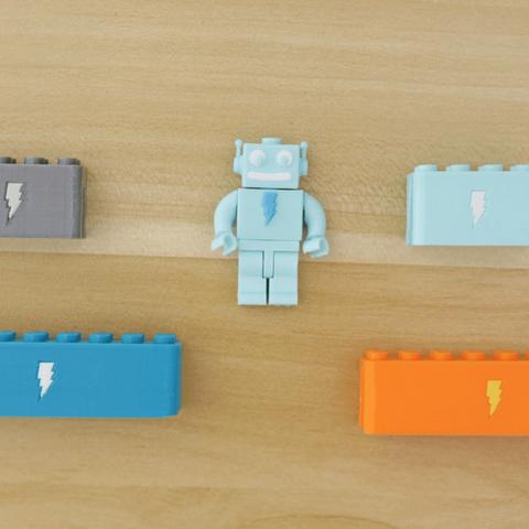 Capture d'écran 2018-03-29 à 10.04.45.png Download free STL file Webcam Cover-Up Lego brick with Adabot Mini Fig • 3D printable design, Adafruit