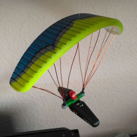 Paraglider with cocoon harness