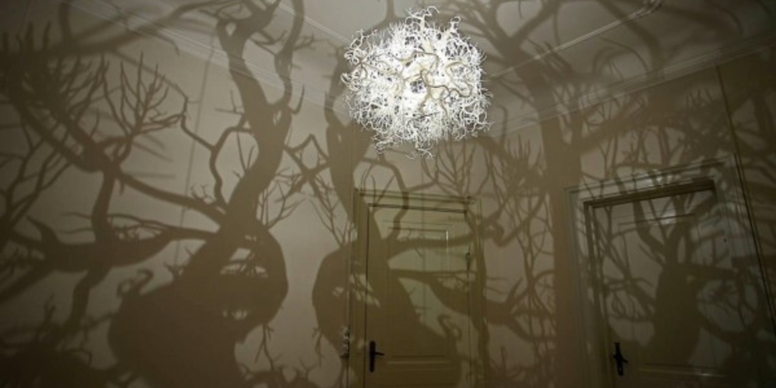 A 3D printed chandelier that creates the atmosphere of a mysterious forest