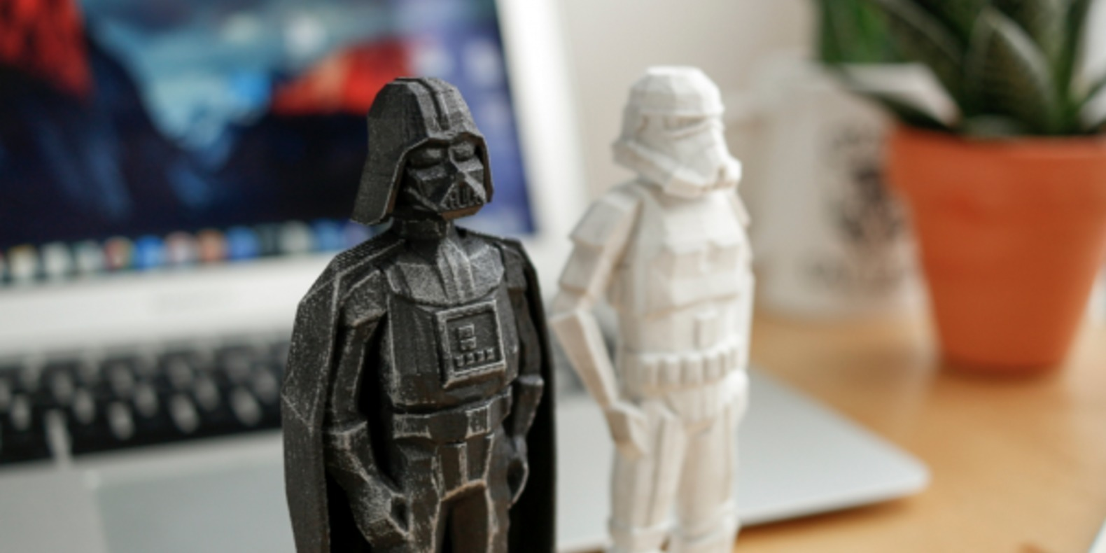 Darth Vader and a Stormtrooper in low poly printed in 3D